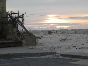 The sun coming up in Long Beach over some of Sandy's destruction.