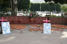 Pink crosses in Olvera Street, Los Angeles, as remembrance for the murdered women of Ciudad Juarez, Mexico, on the Day of the Dead. Source - Para Las Mujeres de Juarez; author - Jim Winstead. CC attribution does not suggest the author and source endorse this work.